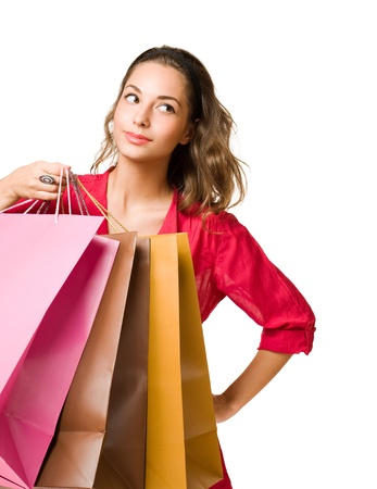 Beautiful young brunette woman with colorful shopping bags  photo
