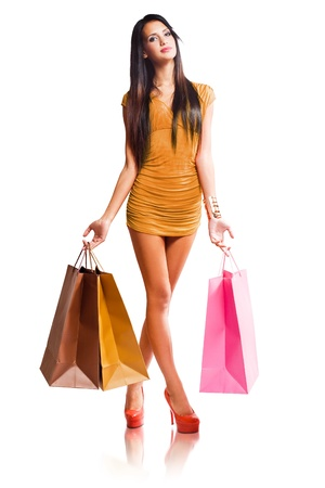 Full length portrait of colorful fashionable shopping girl. photo