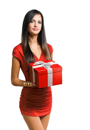 girl in red dress: Portrait of brunette beauty holding bright red gift box.