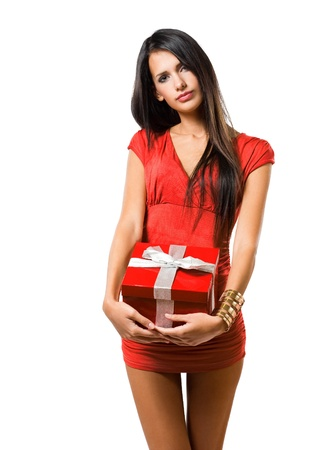 open gift: Portrait of brunette beauty holding bright red gift box.