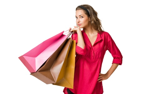 Gorgeous young brunette woman holding colorful shopping bags isolated on white background. Stock Photo - 16334150
