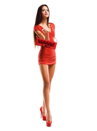long sexy legs: Whole figure shot of gorgeous sensual slender model in little red dress.