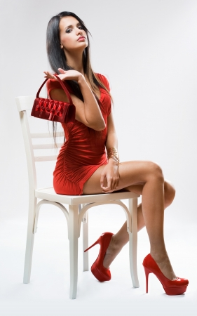 handbags: Portrait of a sensual fashion model in full red outfit.