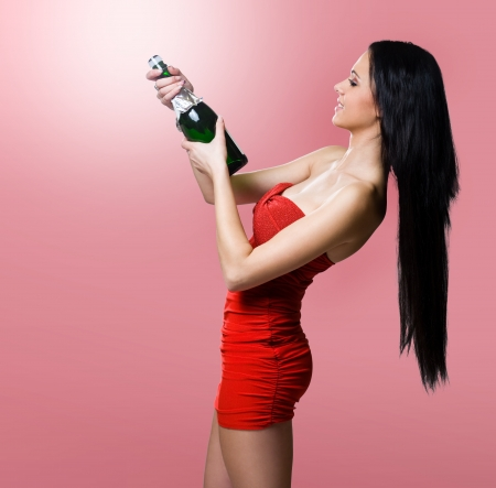 Gorgeous young festive brunette beauty with champagne.