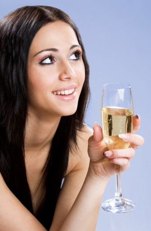 Gorgeous young festive brunette beauty with champagne. photo