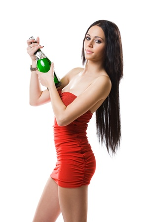 Portrait of elegant brunette beauty ready to open a bottle of champagne. photo