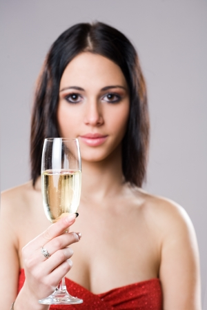 Elegant festive champagne girl, selective focus on the glass. photo