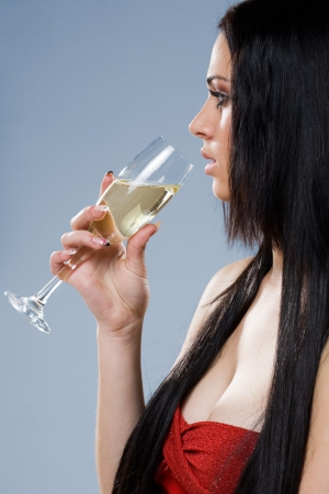 Profile portrait of an elegant dreamy champagne girl. photo