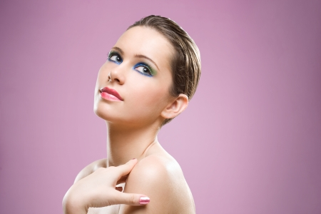 Portrait of feminine beauty in very colorful creative makeup. Stock Photo - 16609812