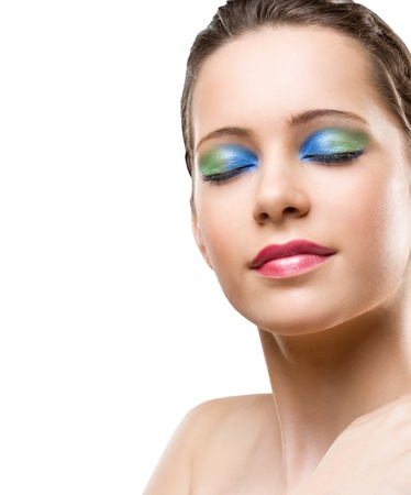 Beautiful young woman in very colorful makeup on white background. photo