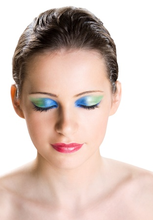 Dreamy young brunette woman with creative colorful makeup. Stock Photo - 16661397