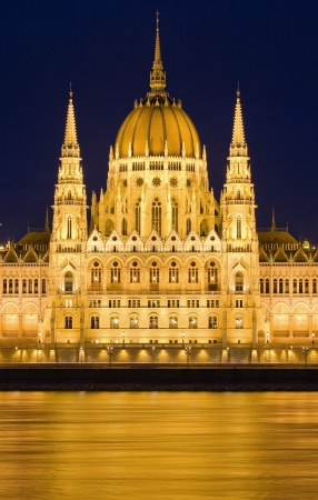 Golden lights at night on the Hungarian Parliament in Budapest.