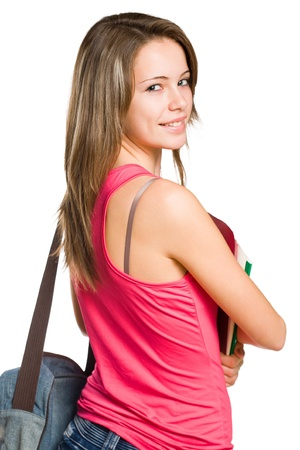 looking over shoulder: Cute young attractive student girl holding colorful exercise books. Stock Photo