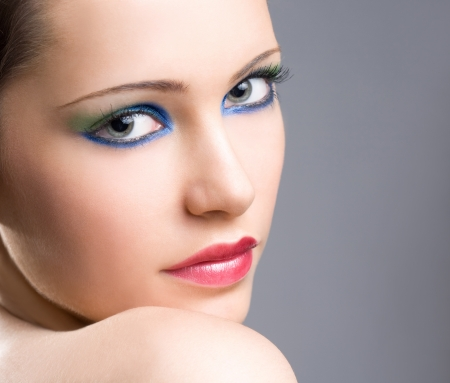 Portrait of a dramatic colorful makeup girl on gray background. Stock Photo - 16695416