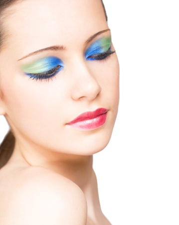 Beautiful young woman in very colorful creative makeup. photo
