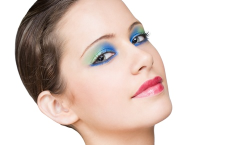 Serene brunette beauty wearing colorful creative makeup  Stock Photo - 16724054