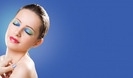 Large long banner with brunette beauty in creative colorful makeup. photo