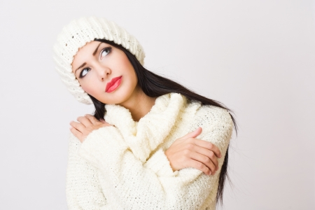 sideways glance: Gorgeous young brunette woman in winter fashion outfit