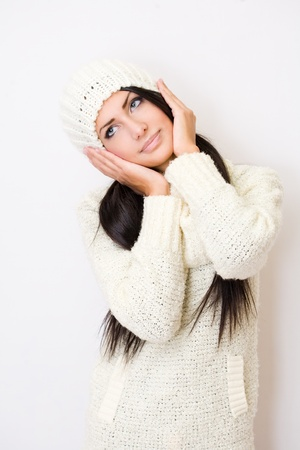 Portrait of winter fashion beauty in warm white sweater  Stock Photo - 17016872