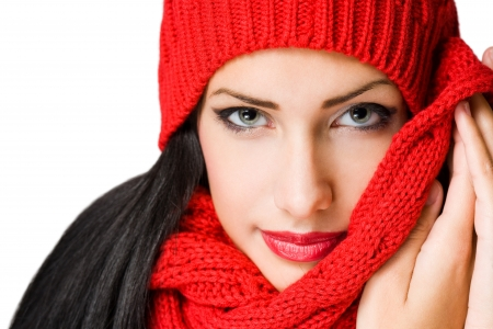 sideways glance: Gorgeous young brunette woman in colorful winter fashion