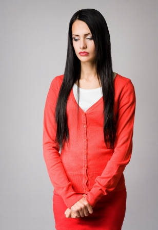 Half length portrait of attractive slender young business woman in pensive pose  photo