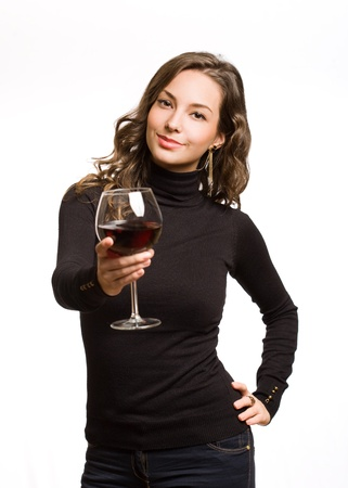 Brunette beauty offering glass of red wine for tasting. photo