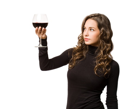 Beautiful young brunette woman enjoying quality wine. photo