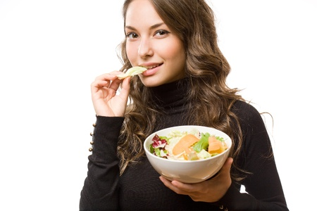 Portrait of healthy eating beautiful young brunette woman. photo