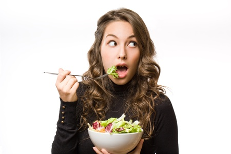 woman eat: Portrait of healthy eating beautiful young brunette woman.