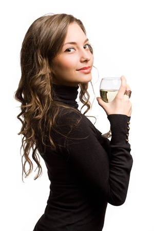 Gorgeous slender young brunette woman holding glass of wine. photo