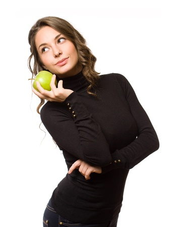 Portrait of gorgeous slender brunette woman holding juicy fresh apple. photo