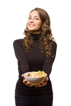 sexy food: Gorgeous young brunette woman with a bowl a of fresh salad.