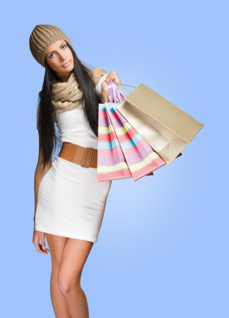 skinny girl: Colorful portrait of a gorgeous young brunette woman with shopping bags.