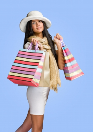 Colorful shot of elegant young woman shopper. photo