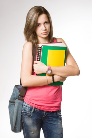 cute teen girl: Portrait of angry, frustrated looking young student girl.