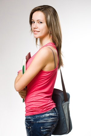 Portrait of an attractive student girl posing in jeans. photo