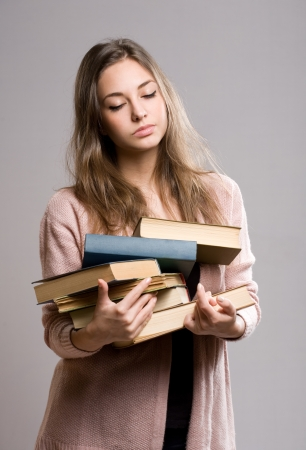 Portrait of a tired looking young beautiful student girl. Stock Photo - 17566343