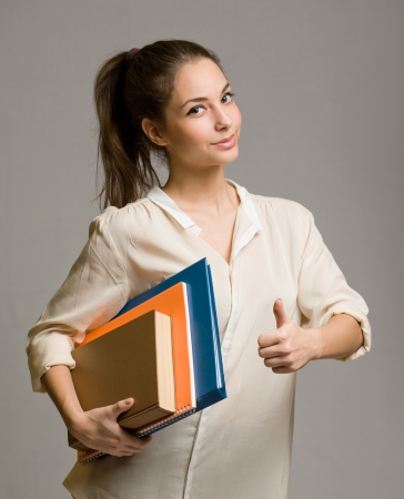 Portrait of happy confident young student woman. photo