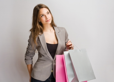 Portrait of a gorgeous pensive young brunette shopper. photo