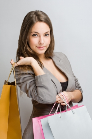 Portrait of an attractive young shopper with colorful bags. Stock Photo - 17576509