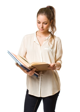 girl reading book: Cute young brunette student girl reading a book. Stock Photo