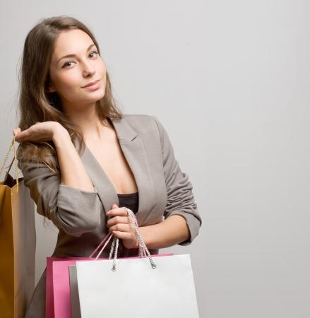 asian shopper: Portrait of attractive fashionable young brunette shopper.