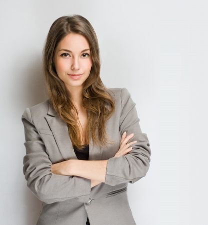 sexy woman standing: Portrait of an attractive stylish young brunette woman.