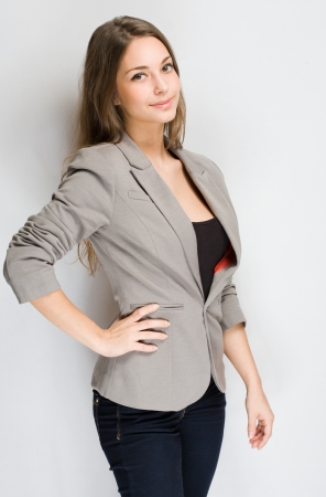 gray suit: Portrait of an attractive stylish young brunette woman.