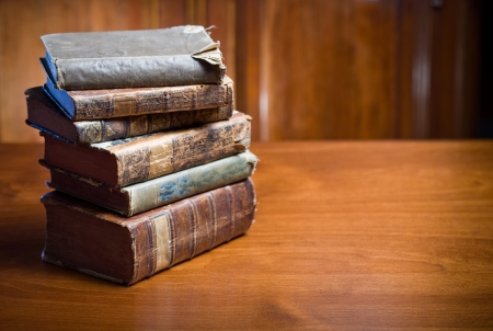 Still life of mysterious looking ancient books in elegant setting. photo