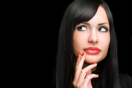 Dark beauty shot of gorgeous brunette with amazing red lips and nails