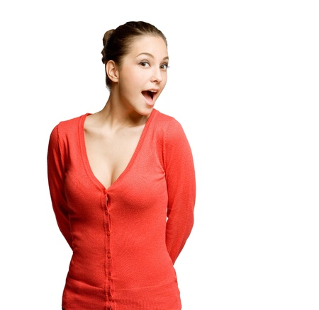 Portrait of a funny shocked looking beautiful young brunette woman  photo