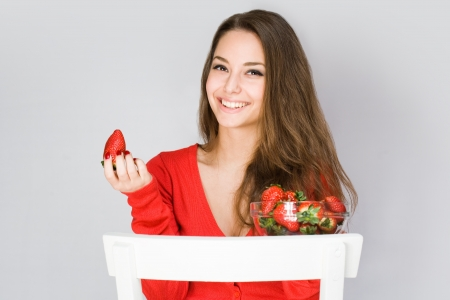 Portrait of grogeous healthy happy young woman with fresh strawberries  photo