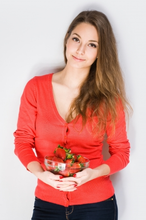 Portrait of serene brunette beauty with fresh ripe strawberries  photo