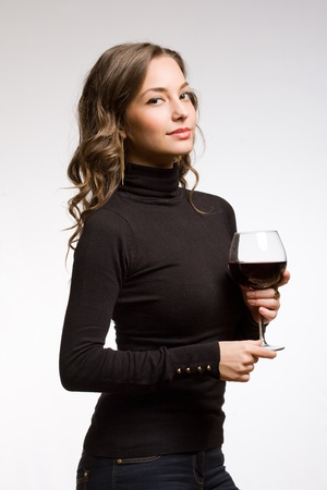Portrait of a gorgeous young brunette woman enjoying premium wine  photo